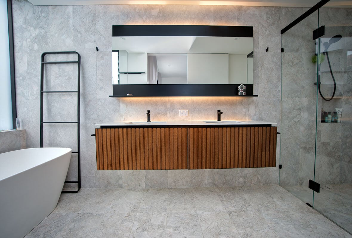 Marble and Wood bathroom with custom built cabinets