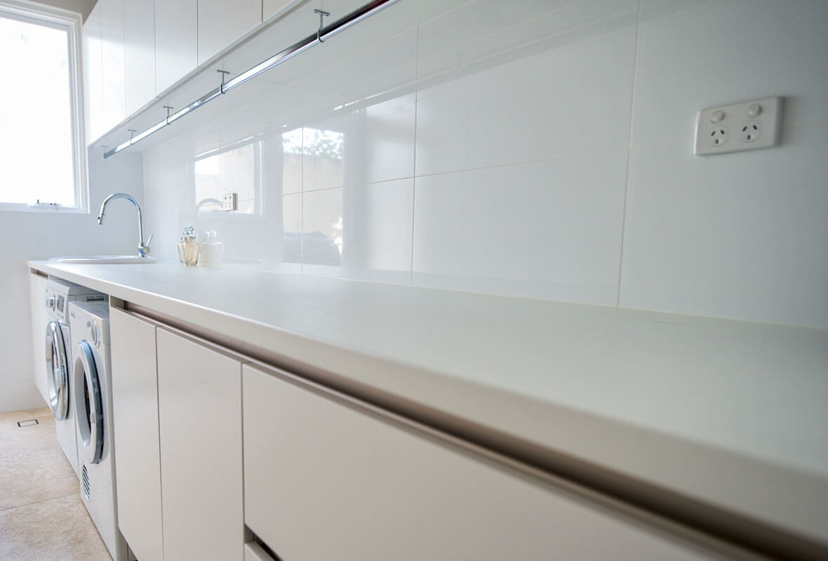 Custom built and fitted laundry cabinets