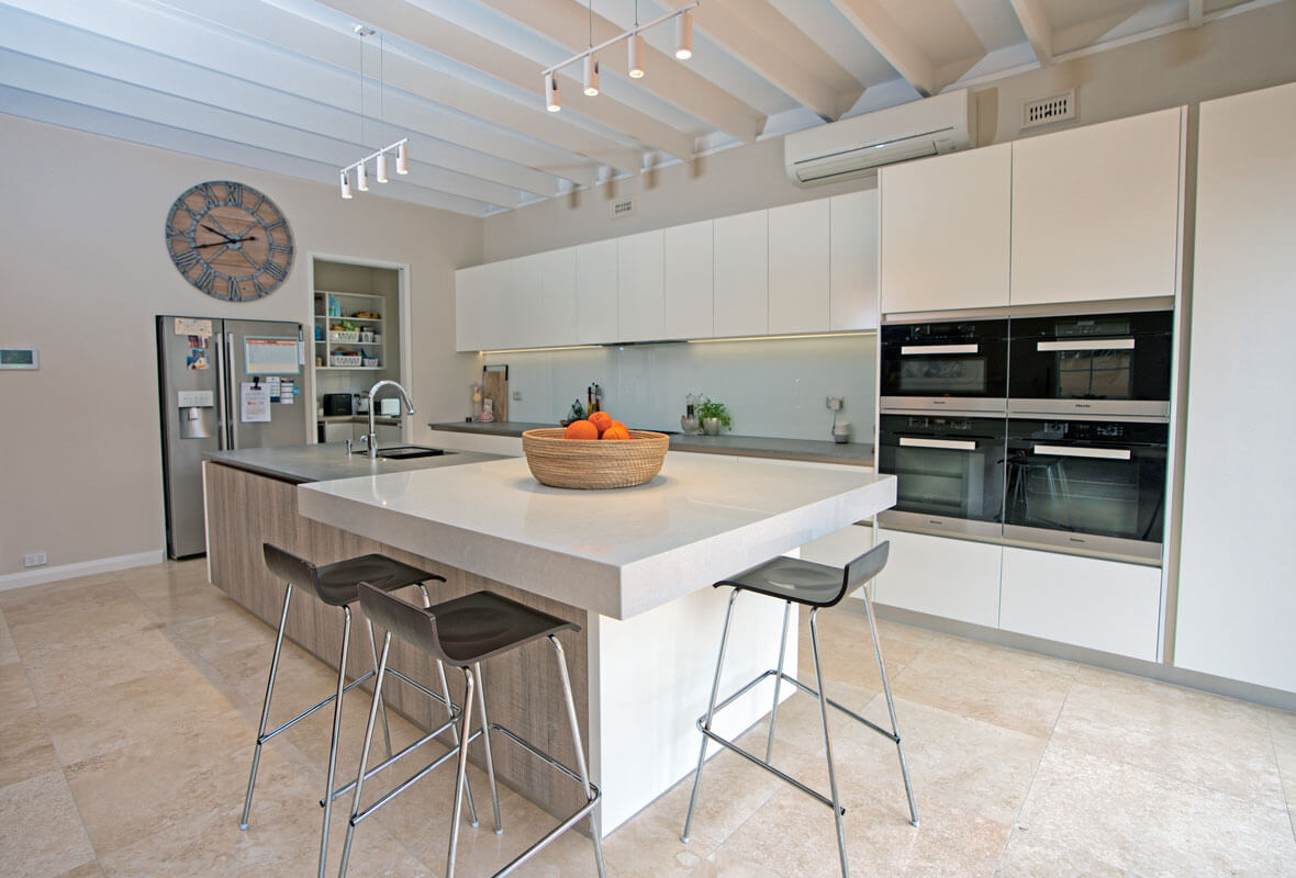 Modern white kitchen with custom built cabinetry