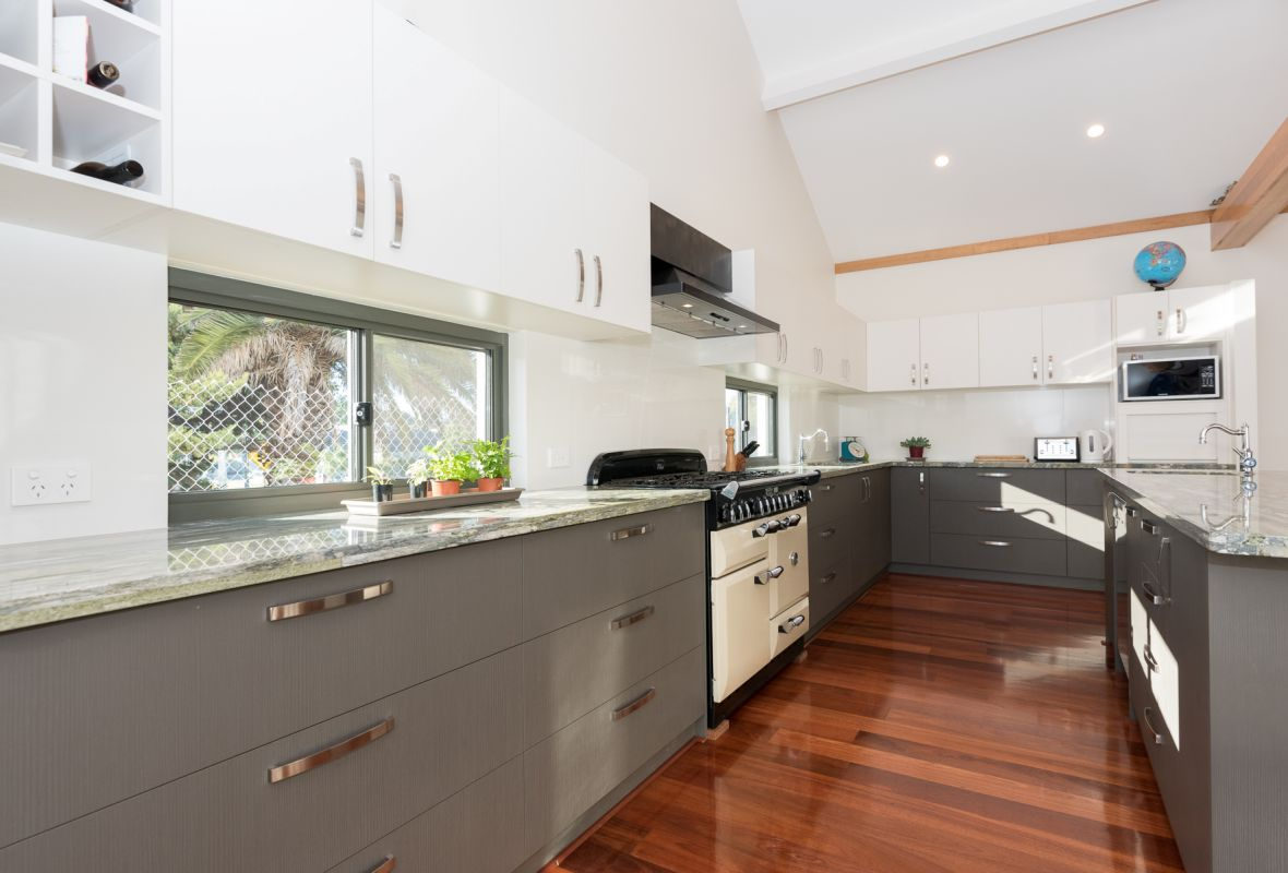 darker colour kitchen cabinets and timber flooring.